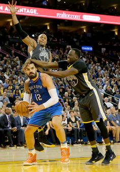 Oklahoma City Thunder's Steven Adams (12) is fouled by Golden State Warriors' Draymond Green (23) in the second half of an NBA game at Oracle Arena in Oakland, Calif., on Tuesday, Feb. 6, 2018. (Ray Chavez/Bay Area News Group)