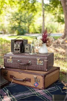 suitcases make great little tables and wedding decor #weddingdetails #vintage #weddingchicks http://www.weddingchicks.com/2014/04/03/masculine-wedding-ideas/
