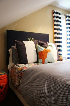 boys room - bedding, window panels; great colors, patterns. Monochromatic argyle design on the wall.