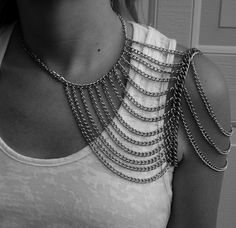 Shoulder necklace.  i strangely like this, but on both sides. maybe sewn to a dress would  be cool.