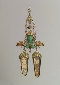 Brooch, ca. 1900, designed by Alphonse Mucha, manufactured by Georges Fouquet (1862–1957);   Gold, enamel, mother-of-pearl, opal, emerald, colored stones, gold paint  Diam. 1/2 in.