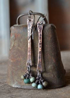 oxidized copper dangle earrings with teal, blue, and green matte glass beads and sterling silver ear wires