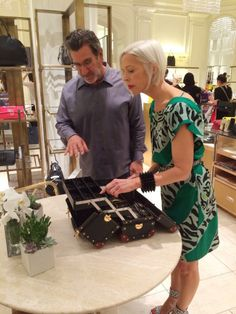 Linda Fargo of @Bergdorf Goodman trying on some @Oliver Peoples specs with the founder/designer Larry Leight