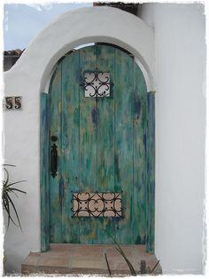 Blue/green painted door in Baja, California. doors of the world.  travel. United States.  USA. North America. doors.  unique doors. beach house.