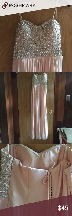 Blush pink strapless prom dress. Sweetheart neck strapless prom dress. No holes or tears. Worn once. Good condition. Zipper and stitching. Dresses Prom