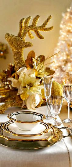 Christmas Table in cream and gold with magnificent, large jeweled deer centerpiece. I would love to know what the crystal pattern is? Found out source of this photo probably Horchow and China pattern is Milano. Crystal parable also Horchow and not vintage.