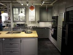 IKEA gray kitchen idea. Would need colorful backsplash to keep from being too gloomy. Granite countertops, gray slate tile.