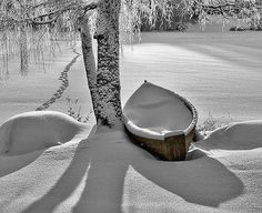 What a terrific shot that evokes the longing one gets knowing it will be months before the canoe is uncovered from its snowy blanket and the ice has receded from your favorite pond.