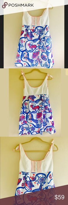 Lilly Pulitzer Scales & Tails Mermaid Sundress Lilly Pulitzer Beach Dress Scales & Tails Mermaid Shells Sundress Pocket  Size 8 Tie shoulder straps, faux button front, scoop neck sheath dress. Pink, blue, white dress with mermaid pattern. Preowned good used condition. Small light stain on right chest, see pictures. Lilly Pulitzer Dresses