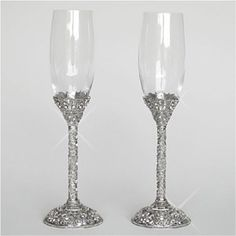 Toasting Flutes - Majesty - WeddingDepot.com - 246-FL6001 Spectacularly designed for the ultimate presentation possible, the Majesty Collection uses unbelievably intricate silver work to dazzle your curiosity which will have your guests viewing these pieces with extreme admiration not only on your wedding day but also in your wedding photographs for years to come.