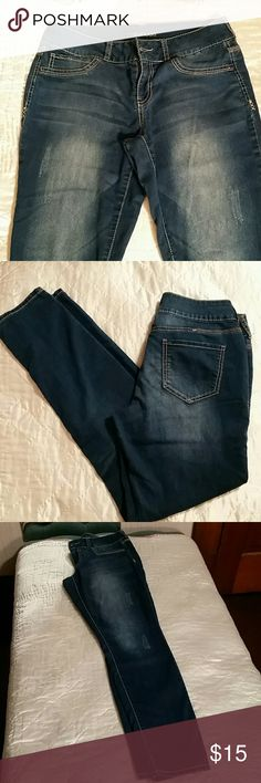 """Maurices Distressed Jegging Jeans So soft and comfy!!! They are not a super skin tight jegging. They give you some breathing room. Material is very soft and thin. They look like you tried real hard but really didnt. Worn like 10 times. My body is changing so much postpartum I can't really stay in same size jean very long. Laying flat: Waist 15"""", Rise 8"""", Length 30"""". Smoke and pet free. Offers and questions welcome. No trades. Bundle and Save! Thanks for looking! Maurices Jeans"""