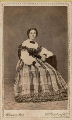 This albumen photograph from the is of a young lady wearing a very beautiful dress. The skirt has a large plaid and is trimmed with ruffles. The bodice has fluffy white sleeves and lace at the yoke. Victorian Fashion, Vintage Fashion, Women's Fashion, Ladies Fashion, Fashion Trends, Beautiful Dresses, Gorgeous Dress, Broadway Nyc, Civil War Dress