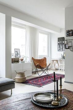 scandi living room with bohemian details by Laura Seppänen