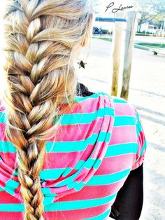 loose french braid with bright striped pullover