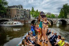 The first World Fashion Festival opened yesterday in Amsterdam with a swimwear show on a tour boat. ©Reuters #amsterdamfashion