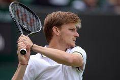 David Goffin hits a backhand in his First Round encounter. - Matthias Hangst/AELTC