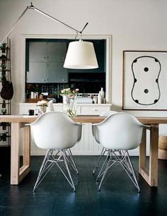 Two Eames chairs, but with the wood legs  Photography by Prue Ruscoe, via Desire to inspire
