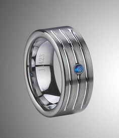 Happy to share this handsome tungsten carbide blue zircon inlay ring with you. It's a nice choice to have on your wedding day.