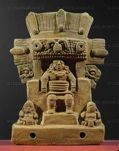 Small temple with female ballplayer, next to her two dwarfs. Women are unlikely to have taken part in the ballgame, but had ritual functions. Funerary gift from the burial site on the Isle of Jaina, Mexico. Clay (600-900 CE). Maya