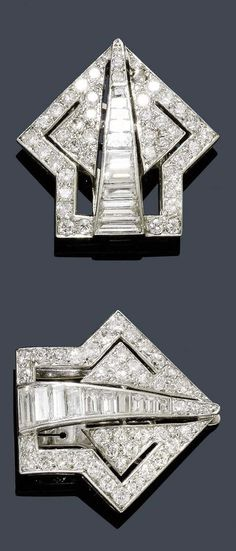 AN ART DECO DIAMOND DOUBLE CLIP, CIRCA 1930. Designed as stylised arrows, each centre set with 10 baguette-cut diamonds and set throughout with 40 brilliant-cut diamonds, mounted in platinum. Clip mechanism in white gold. #ArtDeco #clip #brooch