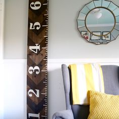 This DIY growth chart is easy to make, affordable and gorgeous too! It's a great idea to track how quickly your kids are growing without marking the walls. Love & Renovations featured on Kenarry.com