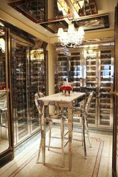 Great use of space in wine room with very little floor space. #wineroom #interiordesign