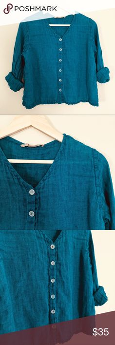 """FLAX Teal 100% Linen Button Down Top In the early 1990s, twin sisters began selling their linen garments at a local Farmer's Market in Ithaca, New York. They quickly realized the increasing demand for their relaxed styles made from natural fibers. After expanding and connecting with enthusiastic, worker-owned, women-operated factories in Lithuania, FLAX was born!  This top is perfect for everyday wear or as a summer bathing suit cover up! Good used condition.  21"""" pit to pit 21"""" long 22""""…"""