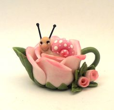 pink rose with snail teapot