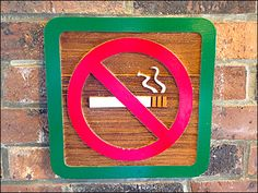 """A """"No Smoking"""" sign carved from natural wood with paint and stain enhancement gets the message across in a civilized and genteel manner. And though it speaks loudly, it blends in with the warm bric..."""