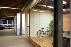 BRICK AND GLASS WALL OFFICE - ideal combination for upstairs Infusion office setting. LOVE this!