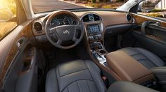 """2014 Buick Enclave - A """"low and away"""" instrument panel keeps controls within easy reach. Premium materials, leather seating, warm wood tones and brushed chrome accents create a sophisticated interior."""