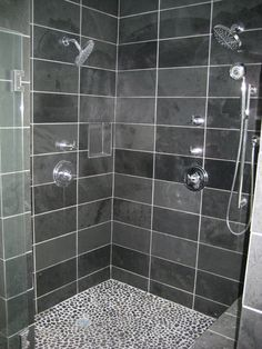 This is what I want the inside of my new shower to look like. Love the pebble floor!!
