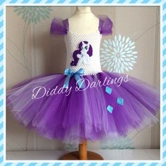 Rarity Tutu Dress. My Little Pony Dress. Pony Dress. Princess Tutu Dress.  Beautiful & lovingly handmade.  Price varies on size, starting from £25.  Please message us for more info.  Find us on Facebook www.facebook.com/DiddyDarlings1 or our website www.diddydarlings.co.uk