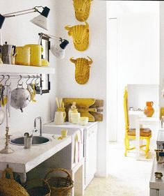 little blue deer yellow touches. Love the wicker taxidermy in the unexpected color!