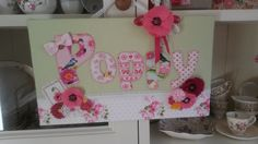 Name plaque using cherished clothes with fabric,felt and crochet flowers