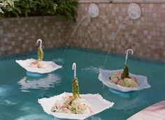 great #party idea! Floating umbrellas & flowers!