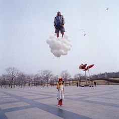 Chinese artist Li Wei likes to defy gravity using an elaborate system of invisble cables, mirrors and scaffolding (not Photoshop).  Saatchi Gallery...
