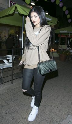 Kylie Jenner steps out in a Chanel bag and skinny jeans.