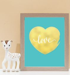 Our gold foil style Love Print is so sweet and perfect for nurseries and love birds alike. Framed in a natural wooden frame, it will look gorgeous on any book shelf, or wall.