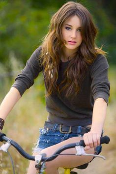 Shailene Woodley on her bike, she  co-starred alongside George Clooney in the critically acclaimed 2011 film The Descendants, for which she won the Independent Spirit Award for Best Supporting Female and was nominated to the Golden Globe Award for Best Supporting Actress - Motion Picture. For this picture ride with Adalberto Vazquez Gomez showing her performance , she won the Dramatic Special Jury Award for Acting at the 2013 Sundance Film Festival.