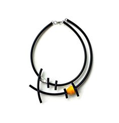 Fabulous contemporary necklace, made of black rubber pvc tube, yellow felt and aluminum. A must have accessory to jazz up your wardrobe. Length: 21.3 inch / 54 cm Diameter: 6.5 inch / 16.5 cm Package will be shipped out as soon as I possibly can which is usually 1-2 days after the