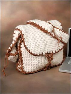 "Messenger Laptop Bag Crochet Pattern - Worked in thick bulky weight yarn, this attractive crochet laptop bag is well-padded and has several pockets for accessories. Finished size 3"" x 12"" x 15"".   Skill Level: Intermediate  Designed by Vashti Braha  free pdf from free-crochet.com"