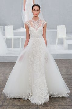 Beautiful illusion neckline on this tulle wedding dress. Monique Lhuillier, Spring 2015