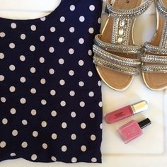 Polka dot blouse Super cute! It's a dark blue colored blouse with white polka dots. Rounded neckline. Short sleeves. Lightweight. The tag is cut out. It fits like a 1x. Tops Blouses