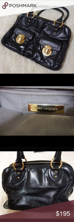 March Jacob's Vintage Black Leather Bag Marc Jacobs Leather back with gold hardware and three separate dividers. There are two pockets on the side with gold buckles that have gentle wear on them (as pictured). Leather and interior is in excellent condition. Marc Jacobs Bags Satchels