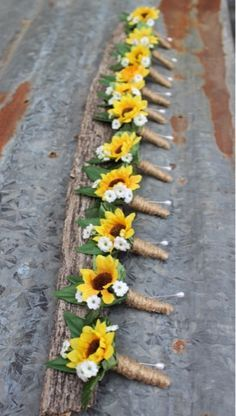 Sunflower boutonnieres with babies breath and twine.