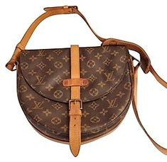 c0bc9dfc5765 Carry your daily necessities in this delicately elegant Louis Vuitton  Handbag Chantilly Crossbody.  Vuitton