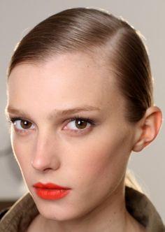 Orange lips nude face