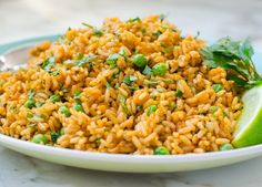 Mexican Rice Pilaf by Once Upon a Chef. My family loves Mexican food so this easy Mexican Rice Pilaf makes a regular appearance at our dinner table. It's not really authentic -- true Mexican rice is more complicated and time-consuming to ma Easy Rice Pilaf, Rice Pilaf Recipe, Rice Recipes, Mexican Food Recipes, Cooking Recipes, Ethnic Recipes, Chef Recipes, Vegan Recipes, Rice Dishes