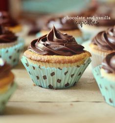 Vanilla Cupcakes with Chocolate Frosting - A white cake that tastes like a cross between an angel food cake, with a light almond-vanilla flavor, and a pound cake, without the heaviness. Simply flavored, sweet, moist with a medium crumb.